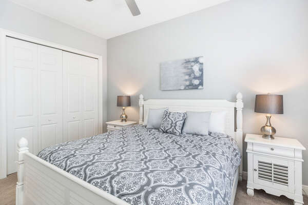 This upstairs bedroom features a King bed