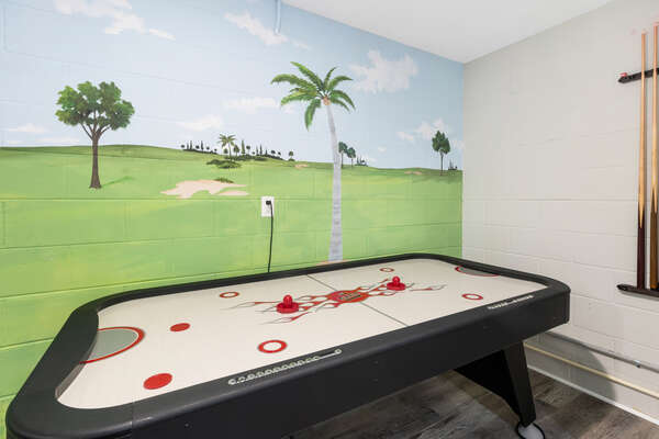 Challenge your family members to a game of air hockey