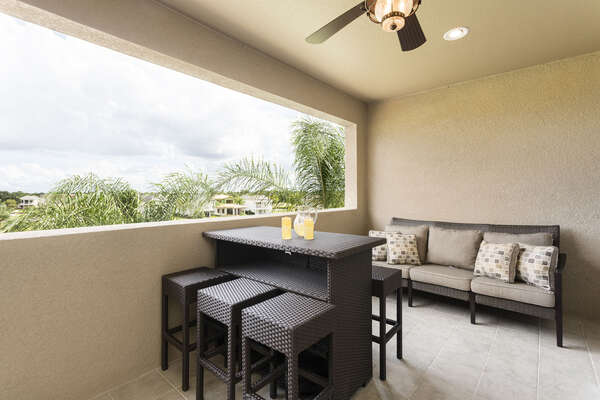 Large balcony with ample seating and beautiful views of Palmer golf course