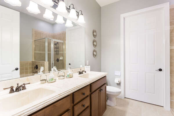 Large his and her sink, jetted tub and a large walk-in closet