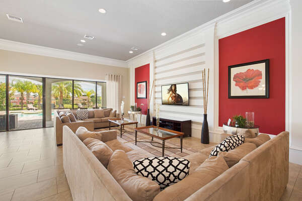 Plush double sectional sofas surrounding the 60-inch SMART TV.