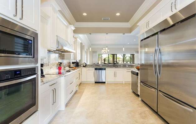Fully equipped kitchen with extra large fridge and stainless steel appliances.