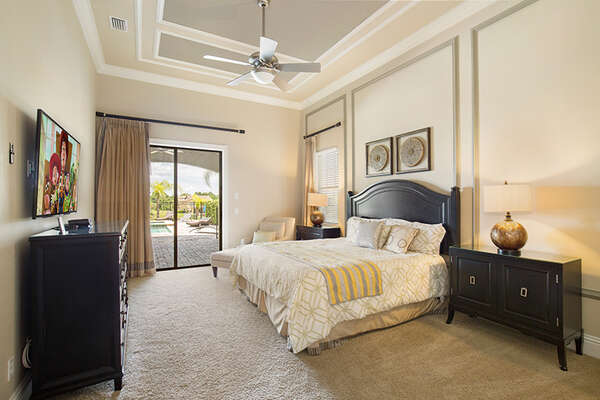 Ground floor master bedroom with sliding glass doors out to the terrace.