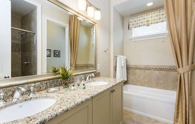 Private ensuite bathroom with dual sinks for him and her.