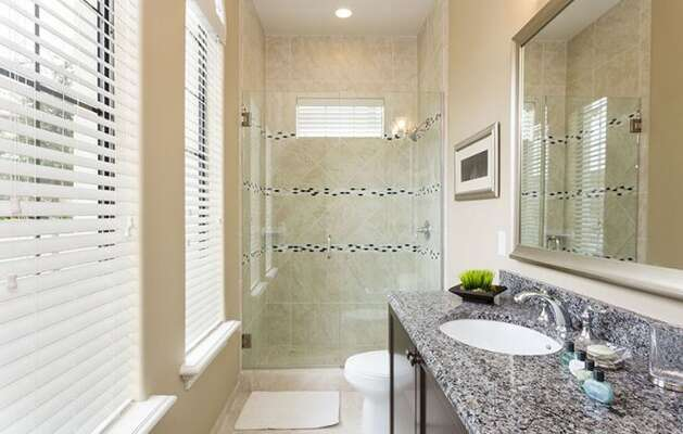 Ensuite bathroom with glass walk-in shower.