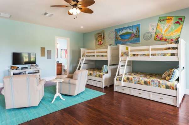Featuring two double bed bunk beds and two pull out trundles this bedroom is perfect for the kids