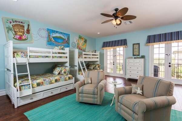 Aloha Hawaiian beach-themed upstairs bedroom 5 opens out onto its own private balcony