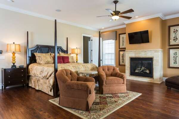 Spacious upstairs master suite bedroom 1 featuring a fireplace