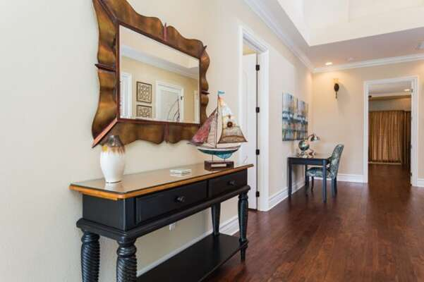 The upstairs of this home features beautiful hardwood floors