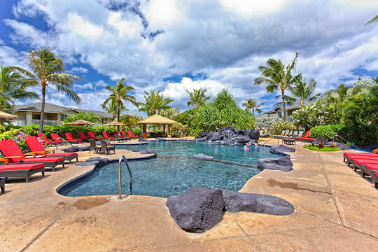 Community Pool with Outdoor Lounge Chairs, and Cabanas.