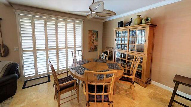 Dining Table, Chairs, Glass Door Cabinet, and Ceiling Fan.