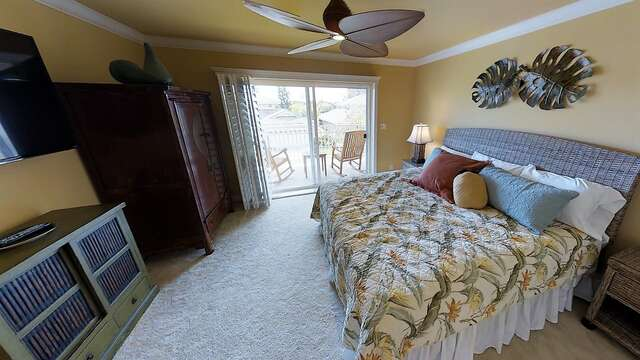 Bedroom with Large Bed, Nightstands, Wardrobe, TV Stand, TV, and Ceiling Fan.