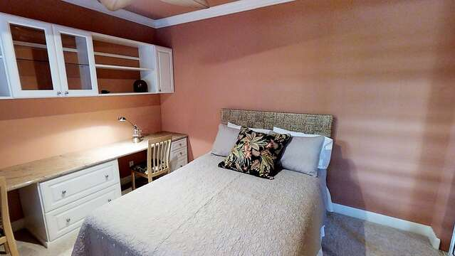 Bedroom with Desk, Wall Cabinet, and Bed.
