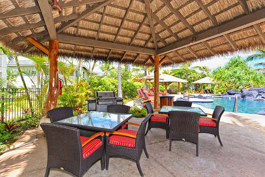 Cabana with Outdoor Dining Tables, Chairs, and Grill.