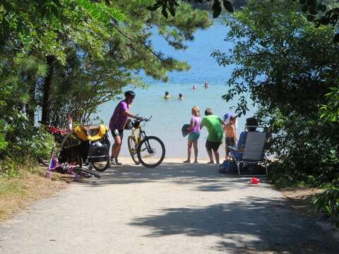 Public access to White Pond Beach just half mile from the house- bike or walk down and enjoy the cool blue waters of the pond. - Chatham Cape Cod New England Vacation Rentals