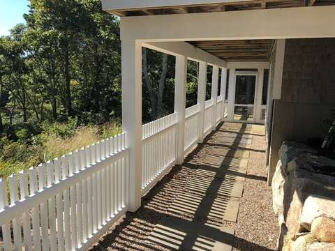 Access out back to the porch - (completely fenced) basement and outdoor shower!  -151 Sky Way Chatham Cape Cod New England Vacation Rentals