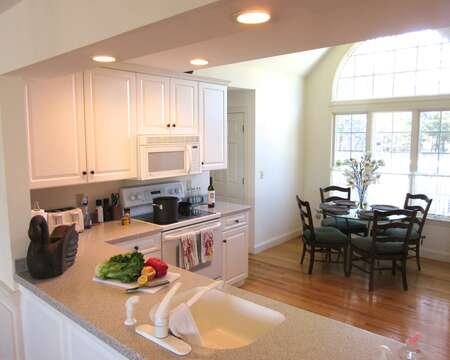 open kitchen with eat in breakfast table- 151 Sky Way Chatham Cape Cod New England Vacation Rentals