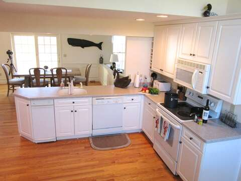 to the left is the open kitchen - 151 Sky Way Chatham Cape Cod New England Vacation Rentals