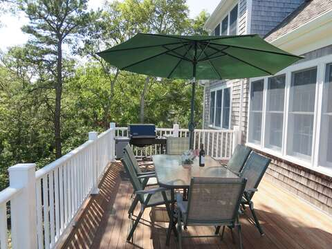plus a table and umbrella for dining with a gas grill as well - 151 Sky Way Chatham Cape Cod New England Vacation Rentals