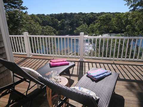 Lounge on the deck and enjoy some summer sunshine and water view! - 151 Sky Way Chatham Cape Cod New England Vacation Rentals