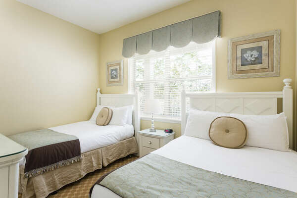 The kids will sleep soundly in this room with two twin beds