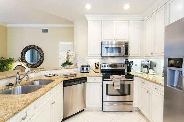 Making meals will be a breeze in this kitchen with granite countertop and stainless appliances
