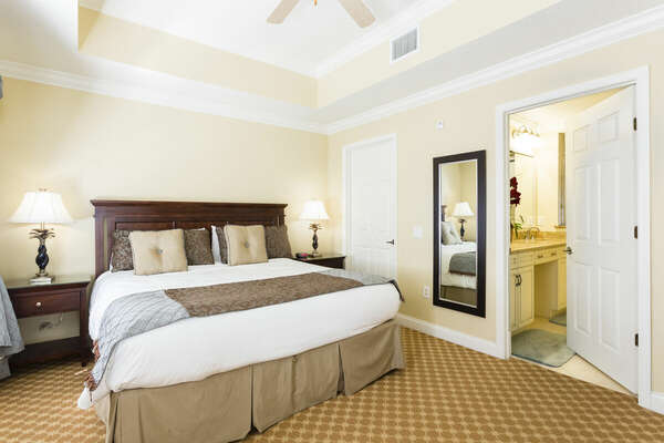 The Master bedroom has a king-sized bed and an en-suite