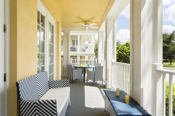 This amazing wraparound porch has ample outdoor seating to enjoy the beautiful views and amazing Florida weather.