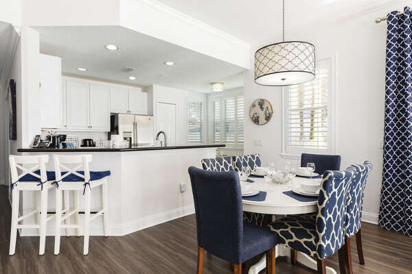 Enjoy family meals at the dining table with seating for 6, or at the breakfast bar with two barstools.
