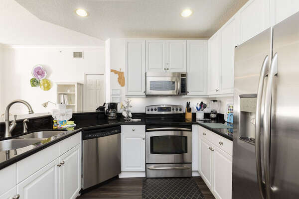 The spacious ungraded and fully-equipped kitchen is great for preparing family meals