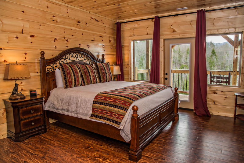 Large Wooden Bed in Bedroom.