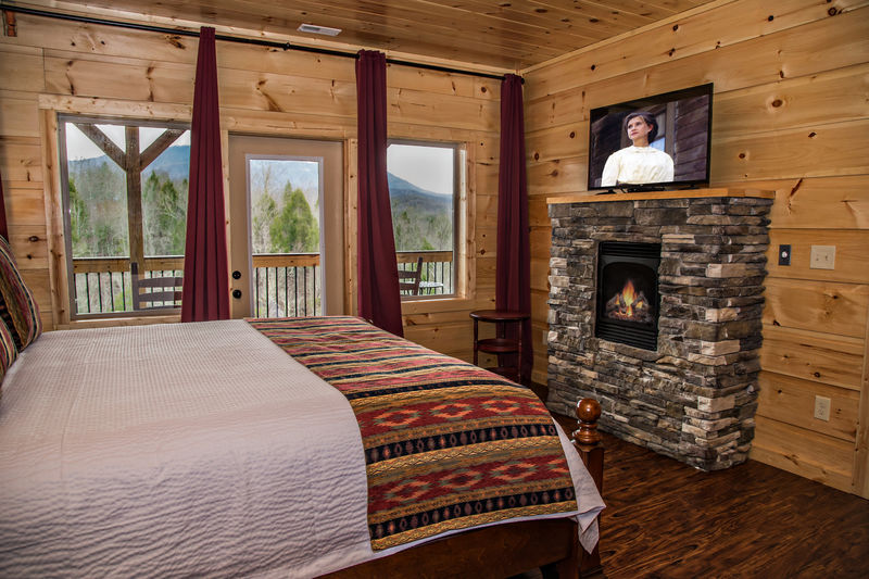 Guests Can Enjoy a Fireplace and TV in Bedroom.