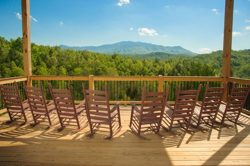 Enjoy Mountain Views From Rocking Chairs on Deck.