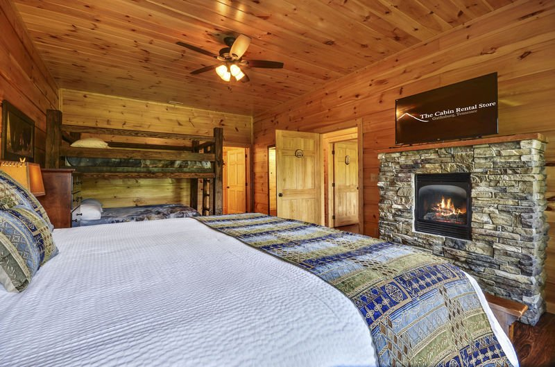 Guests Can Enjoy a Fire While Relaxing in Bed.