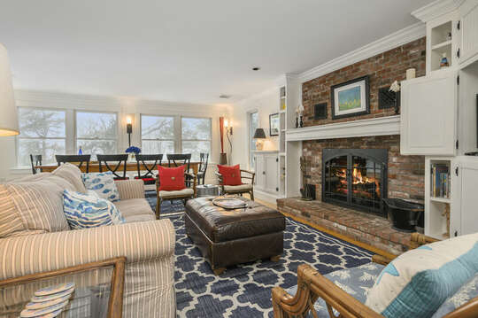 Living room with ample seating and dining area ( fireplace not for guest use)-21 Beechwood Road Centerville Cape Cod New England Vacation Rentals