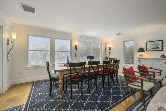 Dining table with bench seat under the windows-21 Beechwood Road Centerville Cape Cod New England Vacation Rentals