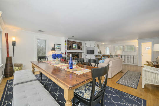 Dining table with bench seat plenty of room for the family to enjoy a meal together-21 Beechwood Road Centerville Cape Cod New England Vacation Rentals