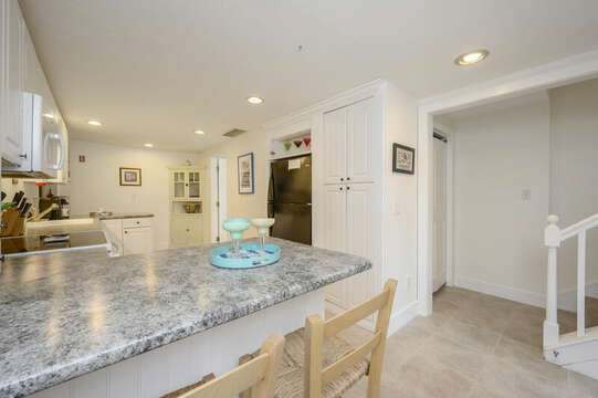 Breakfast bar in kitchen and stairs to bedroom #2-21 Beechwood Road Centerville Cape Cod New England Vacation Rentals