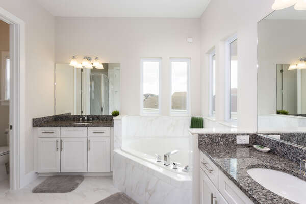 Master bedroom en-suite with dual vanities and a large soaker tub
