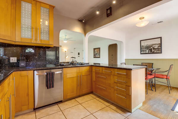 Fully stocked kitchen with dishwasher and kitchen island