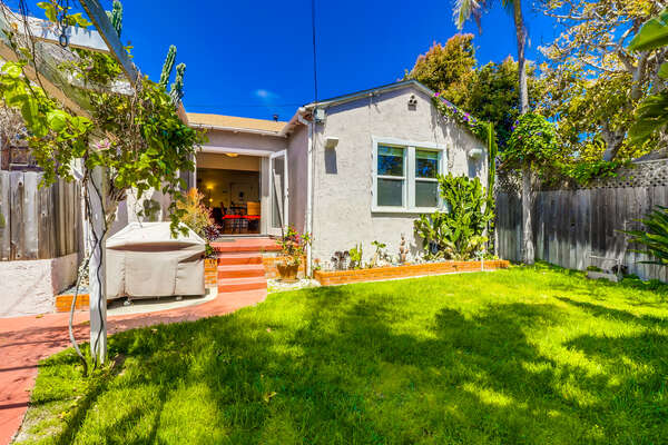 This beach home on pacific beach has a private backyard with a BBQ