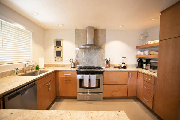 Modern appliances and ample counter space of the Deluxe Kitchen on the First Floor