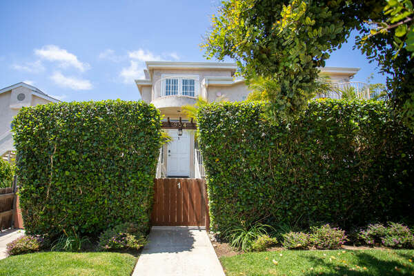 Spacious San Diego vacation home rental with Private Front Patio and large hedges.