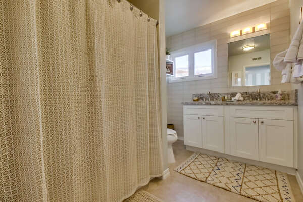 Bathroom with a Tub/Shower Combo in our ASPIN-2627BAY Rental