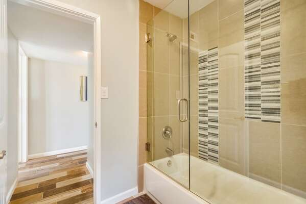 This Bathroom Features a Shower/Tub Combo