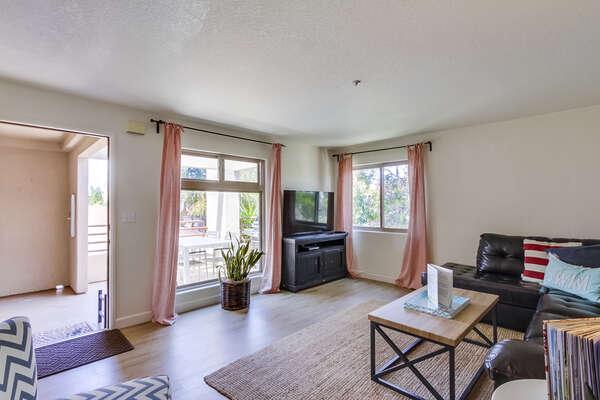 Sofa, Coffee Table, Windows, and TV.