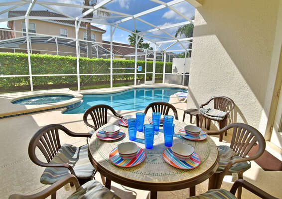 Shaded lanai area with table seating 6
