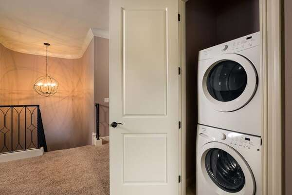 There is also an upstairs laundry room