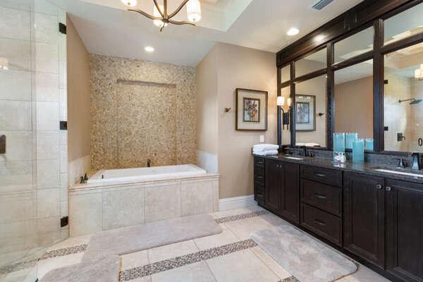The master suite bathroom 1 offers a large tub for relaxation