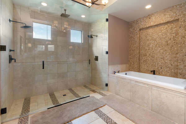 The master bathroom also features a double shower with rain shower heads